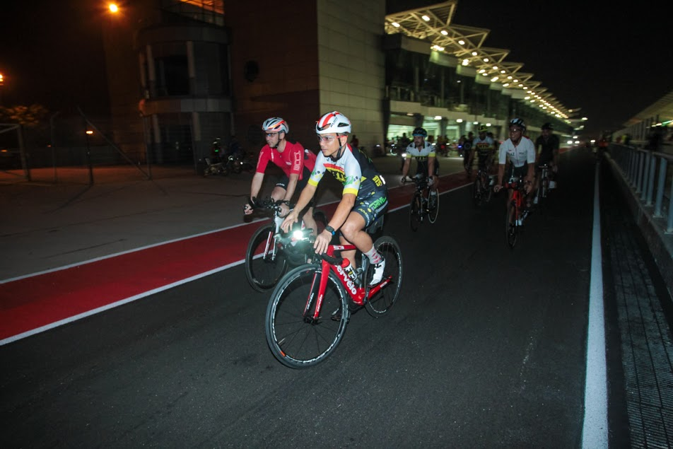 Dato Razlan (in red) cycling on the Formula 1 circuit during the Motorsports Free night at the Sepang International Circuit. (SIC)
