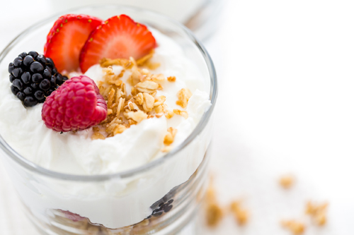 Fruit and yogurt can pack a punch before your swim. (Ironman.com)