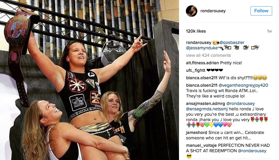 Friends keep fighter Ronda Rousey grounded on her feet. (Reebok)