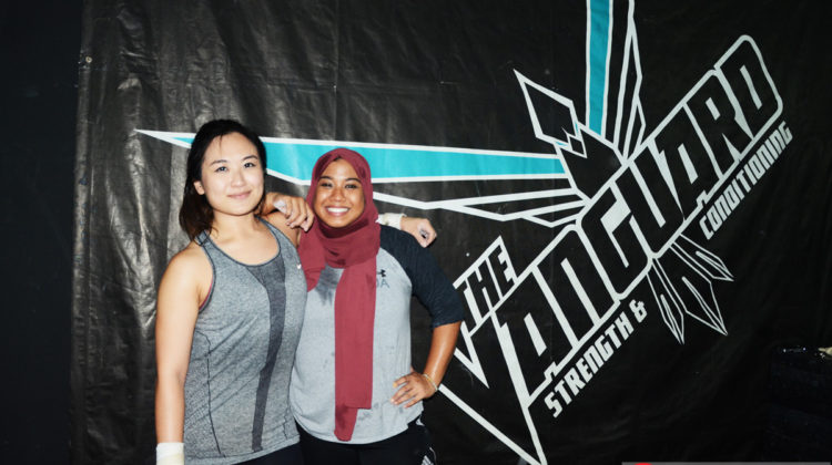 Juinn(left) and Bibah indulges in Weightlifting at The Vanguard in District 13, PJ.