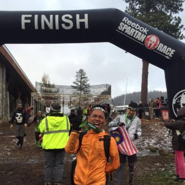 One-arm Spartan, CK Loh conquers the Spartan World Championship at Lake Tahoe, USA in snowy weather. (CK Loh)
