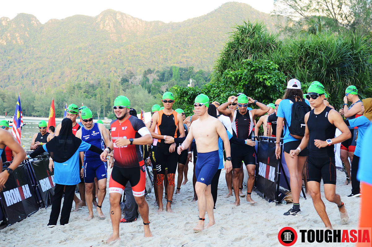Starting off the swim alongside buddy, Dannie Choong (right)
