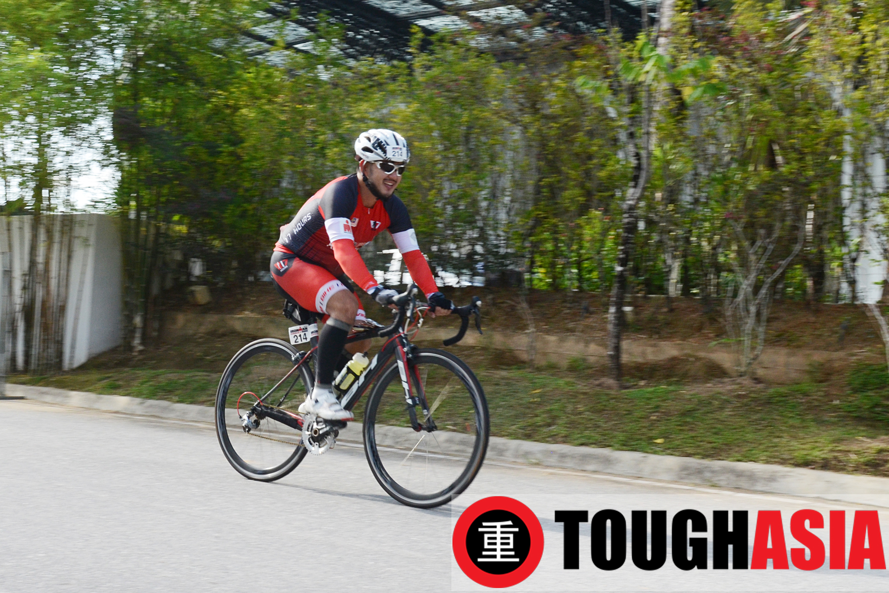 Richard Lee cycling out of Transition 1 and onto the 180km bike route around Langkawi.