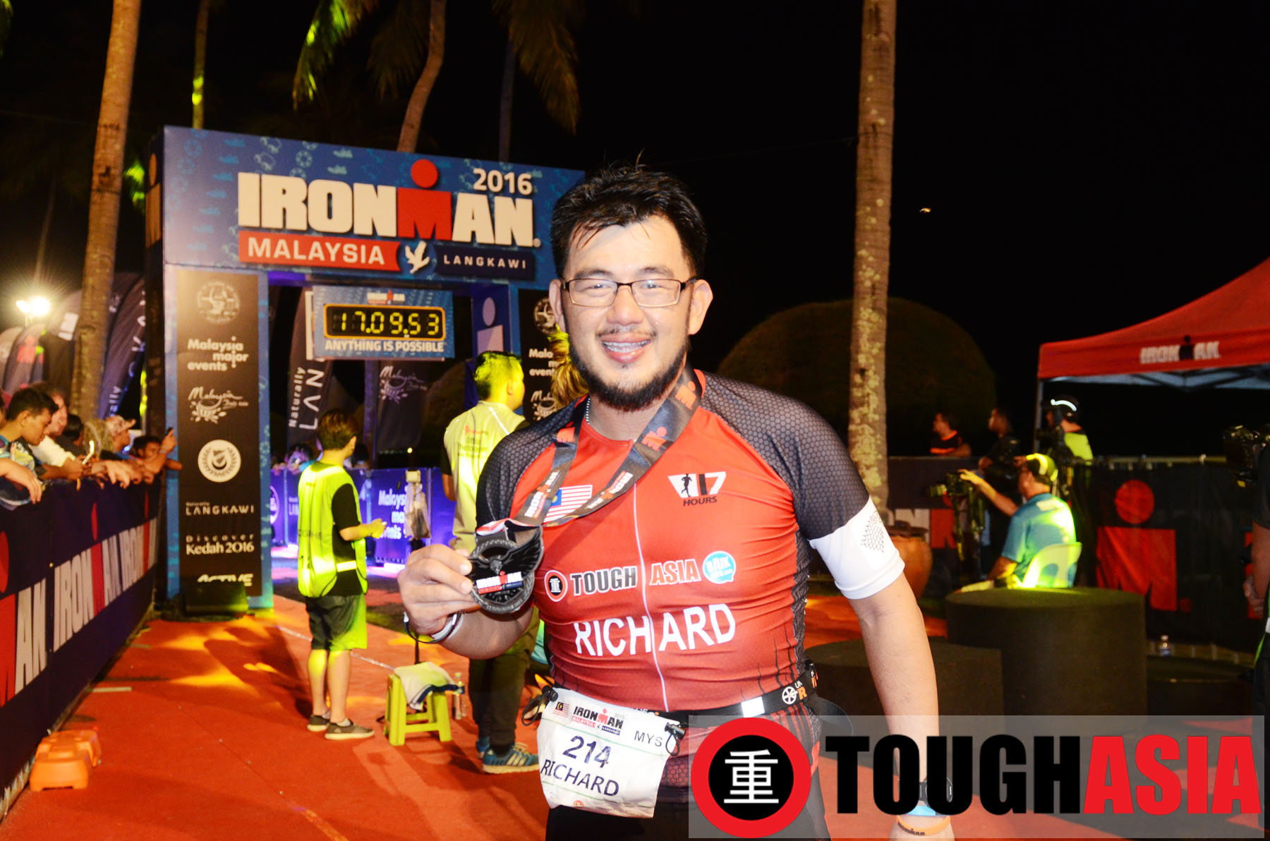 A jubilant Richard Lee, soaking up the euphoria at the Ironman Malaysia finish line.